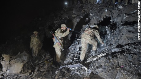 Pakistani soldiers search for victims from the wreckage of the crashed PIA passenger plane Flight PK661 at the site in the village of Saddha Batolni in the Abbottabad district of Khyber Pakhtunkhwa province on December 7, 2016.