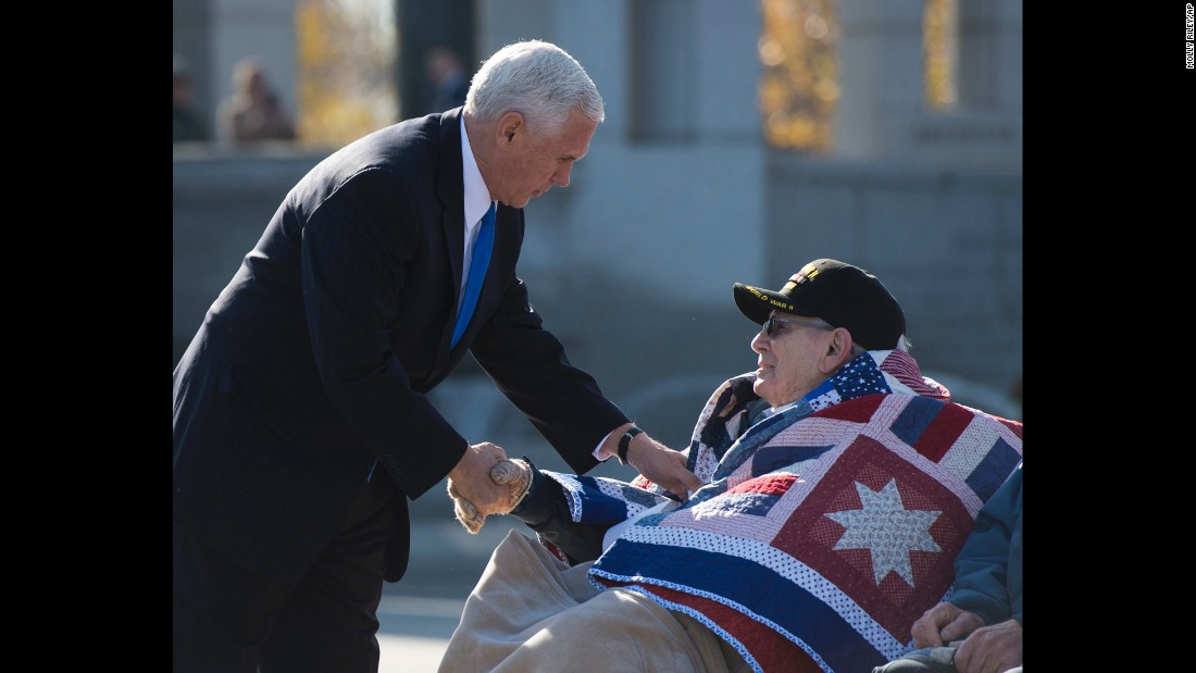Vice President-elect Mike Pence greets WWII veteran William Flatters during a ceremony at the National World War II Memorial in Washington.