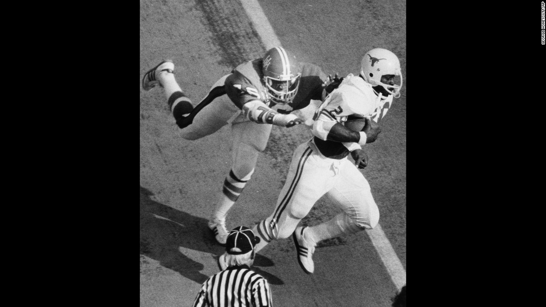 Earl Campbell of the University of Texas runs with the football during a 1977 game against the University of Houston.