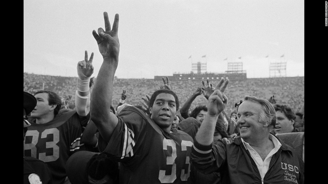 University of Southern California star running back Marcus Allen and coach John Robinson, right, join the rest of the USC Trojans after their victory over the UCLA Bruins in Los Angeles on November 21, 1981.