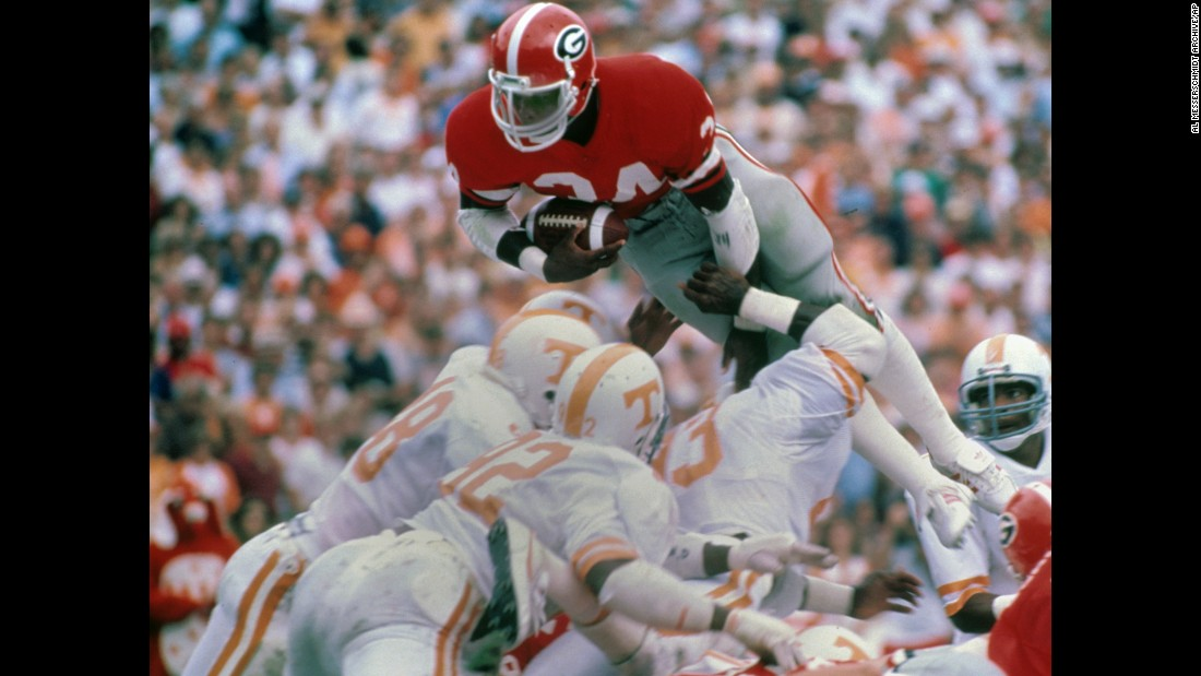 Running back Herschel Walker of the Georgia Bulldogs dives for a touchdown against Tennessee in 1982.