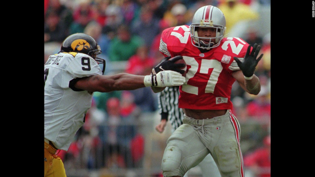 "Ohio State's Eddie George pulls away from Iowa defender Bill Ennis-Inge in Columbus, Ohio, on October 28, 1995. After retiring from the NFL, George took up acting and appeared on Broadway as lawyer Billy Flynn in the musical ""Chicago"" <a href=""http://www.nytimes.com/2016/01/19/theater/eddie-george-leaps-to-chicago-from-the-nfl.html?_r=0"" target=""_blank"">this year</a>."
