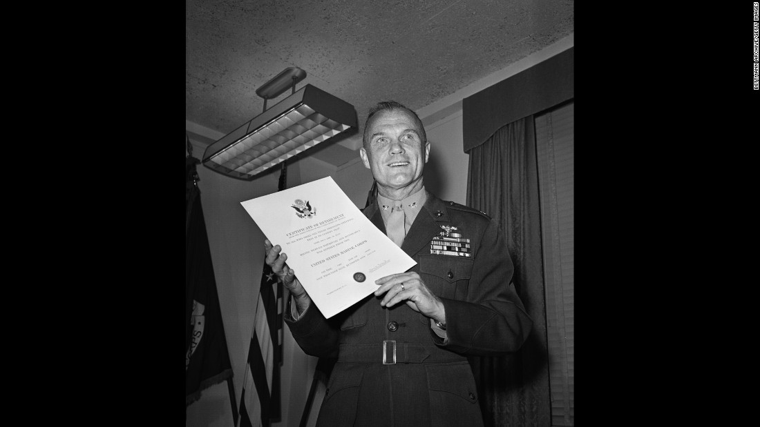 Glenn holds his discharge papers after he retired from the Marine Corps and resigned from NASA's astronaut program. Now a national figure, he went on to become an executive for the Royal Crown Cola Co. He would soon explore a career in politics.