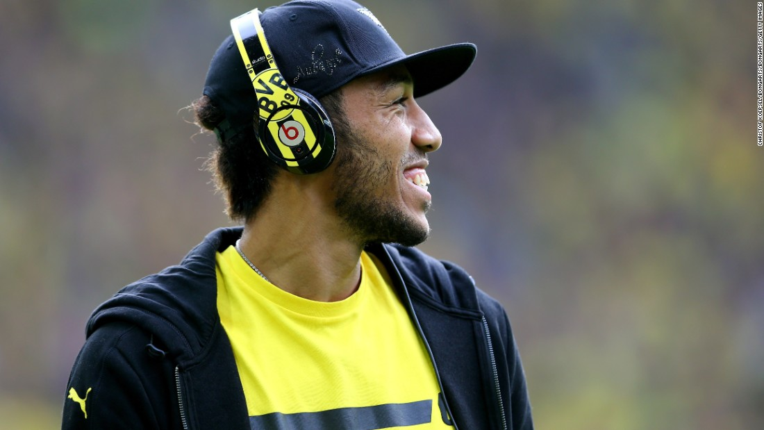 The Gabon international is also known for fashion statements off the pitch, often using a pair of Borussia Dortmund's own brightly colored headphones.