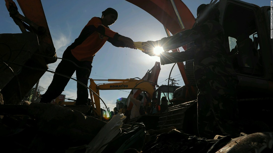 Members of Indonesia's search and rescue team continue to dig through rubble looking for earthquake survivors in Pidie Jaya, Aceh province, on Thursday, December 8. More than 100 people are confirmed dead after a 6.5-magnitude quake struck Wednesday, leveling buildings in the region.