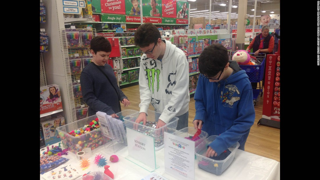 "Adam, Billy and Robert Moser play at a sensory station during the Toys ""R"" Us shopping event in King of Prussia, Pennsylvania, on Saturday. Adam, 10, and Robert, 16, are both on the autism spectrum."