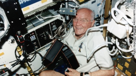 American astronaut John Glenn becomes the oldest person in space during the STS-95 mission on board the shuttle Discovery, 1998. (Photo by Space Frontiers/Getty Images)