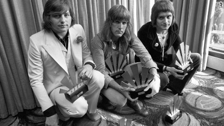 Greg Lake, left, with bandmates Keith Emerson, center, and Carl Palmer in 1972.