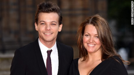 Louis Tomlinson and mother Johannah Deakin attend the Believe In Magic Cinderella Ball in London in August 2015.