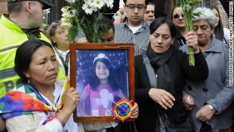 Mourners demand justice holding a picture of Yuliana - a seven-year-old girl who was raped, tortured and murdered - after a mass held in her honour at the Santa Teresita church in Bogota, Colombia, on December 7, 2016.  A seven-year-old girl was raped, tortured and murdered in Bogota this weekend, allegedly by a 38-year-old man who kidnapped the girl from her low-income neighborhood on the east side of the city and took her to a luxury apartment belonging to his family, the police said. The girl's body was found on the scene, showing signs of torture and sexual abuse. / AFP / GUILLERMO LEGARIA        (Photo credit should read GUILLERMO LEGARIA/AFP/Getty Images)