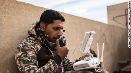 A soldier from the Mosul Brigade of the Iraqi forces operates a drone on December 5.