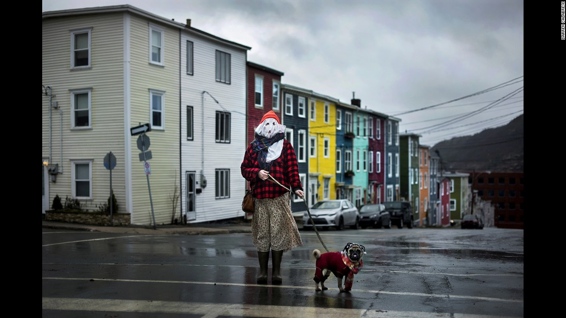 Sarah Ferguson and her dog Frank stand in traditional mummer dress in St. John's, Newfoundland. Mummering involves getting dressed up in disguise using anything one can scavenge -- curtains, lampshades, old clothing -- before going unannounced to neighbors' homes for impromptu kitchen parties. The centuries-old Christmas tradition all but disappeared in Newfoundland and Labrador, but a new generation is starting to revive it, according to photographer Darren Calabrese.