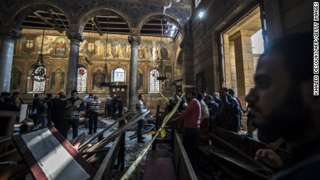 Egyptian security forces inspect the scene of the explosion at the Coptic Orthodox Church.