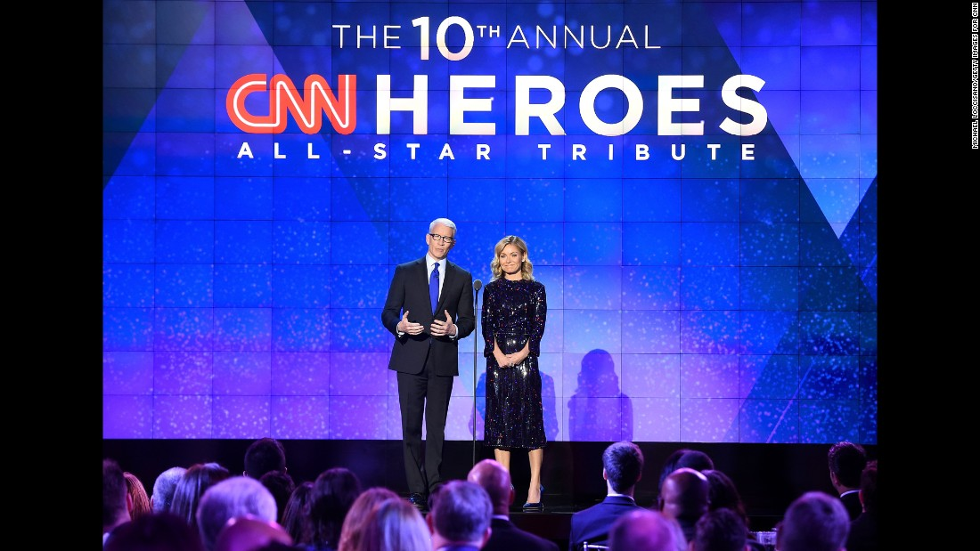 Hosts Anderson Cooper and Kelly Ripa speak onstage during the CNN Heroes gala 2016 at the American Museum of Natural History on Sunday, December 11, in New York.