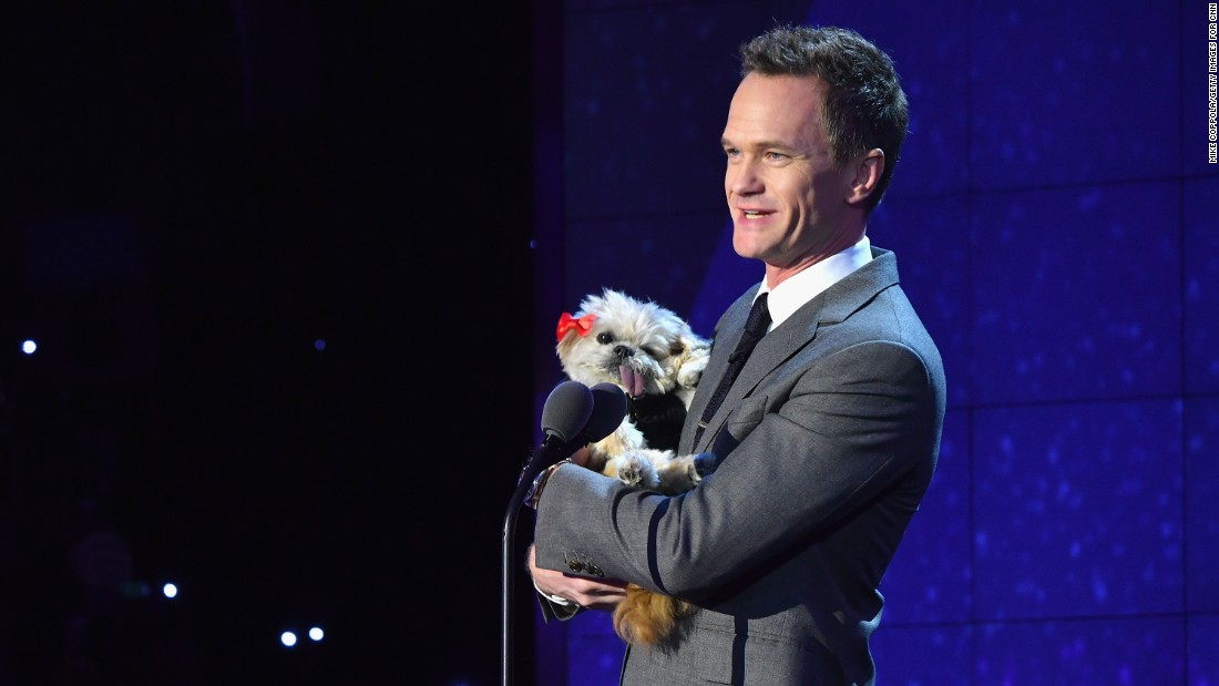 "Presenter Neil Patrick Harris holds Instagram star <a href=""https://www.instagram.com/marniethedog/?hl=en"" target=""_blank"">Marnie the Dog. </a>Harris introduced Top 10 CNN Hero Sherri Franklin, whose nonprofit rescues senior dogs and finds them forever homes."