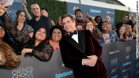 SANTA MONICA, CA - DECEMBER 11:  Actor John Travolta takes a selfie with fans during The 22nd Annual Critics' Choice Awards at Barker Hangar on December 11, 2016 in Santa Monica, California.  (Photo by Christopher Polk/Getty Images for The Critics' Choice Awards )