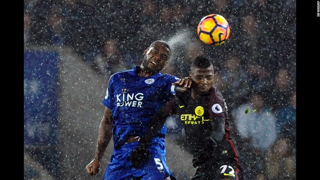 Leicester City defender Wes Morgan, left, heads the ball near Manchester City forward Kelechi Iheanacho during a Premier League match in Leicester, England on Saturday, December 10.