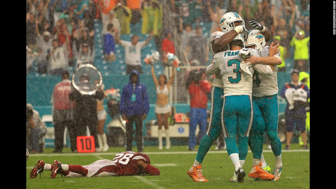 The Miami Dolphins celebrate after Andrew Franks kicked a last-second field goal to defeat Arizona on Sunday, December 11.