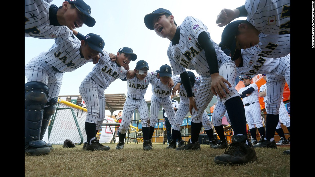 An under-12 baseball team from Japan huddles during a tournament in Zhongshan, China, on Monday, December 12.