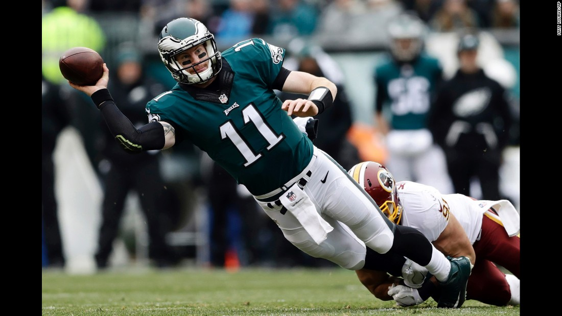 Philadelphia quarterback Carson Wentz is tackled by Washington's Ryan Kerrigan during an NFL football game on Sunday, December 11.