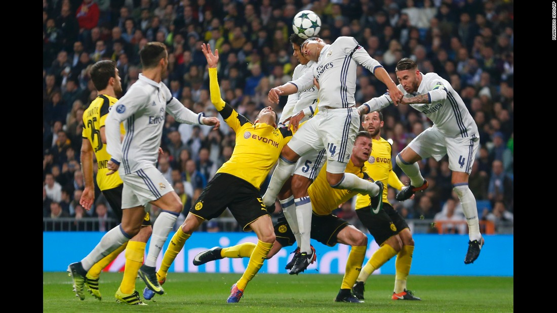 Players from Real Madrid and Borussia Dortmund compete for a header during a Champions League match in Madrid on Wednesday, December 7.