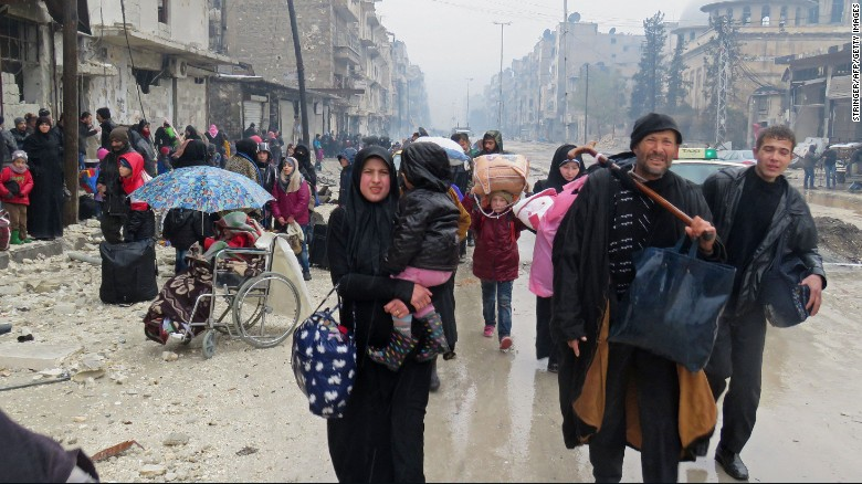 Syrians fleeing the restive Bustan al-Qasr neighbourhood on Tuesday.