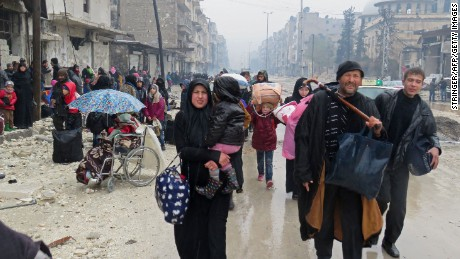 Residents flee the Bustan al-Qasr neighbourhood in eastern Aleppo on Tuesday.