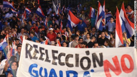 Thousands of Paraguayans protest in Asuncion on December 13, 2016 against the constitutional amendment that allows the presidential reelection. / AFP / NORBERTO DUARTE        (Photo credit should read NORBERTO DUARTE/AFP/Getty Images)