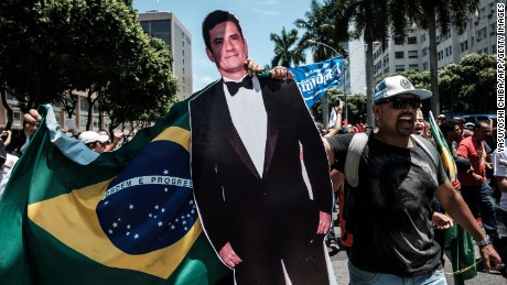 A protester carries a life-size image of Brazilian Federal Judge Sergio Moro, who conducts the Lava Jato (Car wash) operation, the biggest corruption investigation in Brazil's history, during a public servants' demonstration against austerity measures in front of the Rio de Janeiro state Assembly (ALERJ), in Rio de Janeiro, Brazil, on December 12, 2016. On Monday Rio's lawmakers began voting the measures promoted by the governor Luiz Fernando Pezao pushing budget cuts. / AFP / YASUYOSHI CHIBA        (Photo credit should read YASUYOSHI CHIBA/AFP/Getty Images)