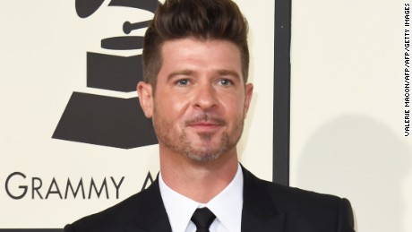 "Robin Thicke's latest album is ""On Earth, and in Heaven."""
