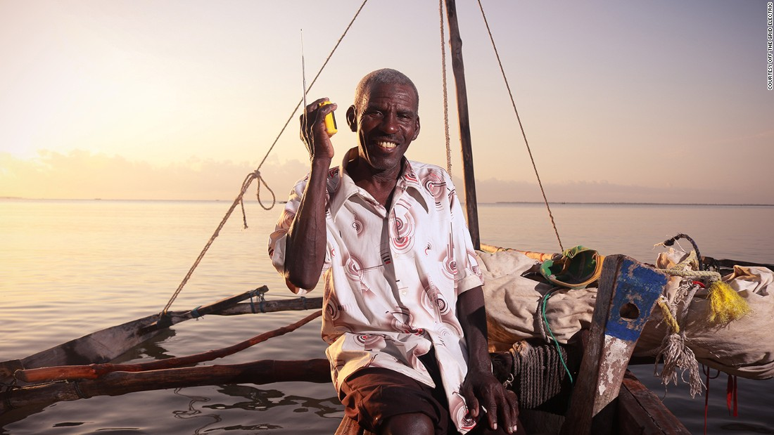 A fisherman in Tanga, Tanzania brings his solar radio with him to listen to the news while working.