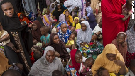 Women and children await treatment at a mobile health clinic in Maiduguri, Nigeria.