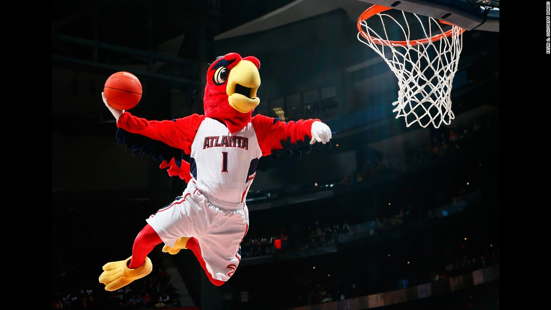 Harry the Hawk shows off his slam dunking skills during a timeout.