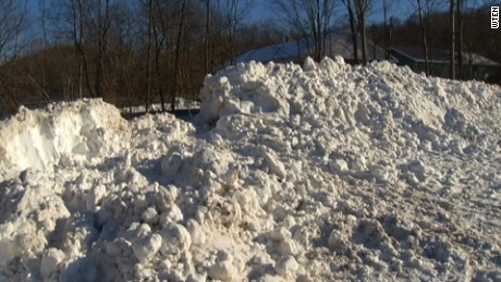 Snow piles up at the scene of the collapse that killed a 13-year-old boy in Greenwich, New York.