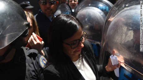 Venezuela's Foreign Minister Delcy Rodriguez, is blocked by riot police officers before entering the Argentine Foreign Ministry in Buenos Aires during a meeting among Mercosur's ministers where Venezuela was not invited, on December 14, 2016. Mercosur's foreign ministers debate on Venezuela's suspension from the group after accusations that the leftist government in Caracas failed to meet democratic and trade standards. / AFP / EITAN ABRAMOVICH        (Photo credit should read EITAN ABRAMOVICH/AFP/Getty Images)
