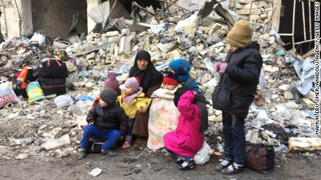 Desperate civilians wait for evacuation from Aleppo on Thursday.