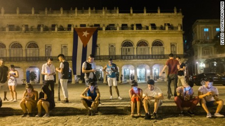 Public Wi-Fi spots, such as this one outside the Santa Isabel Hotel in Havana, have become popular gathering places.