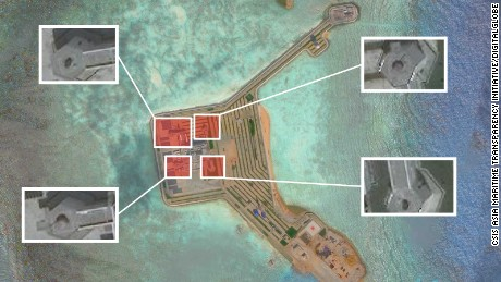 Report: Weapons installed on contested islands