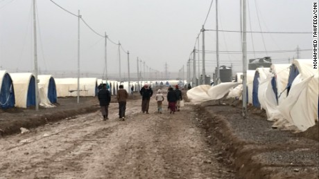 Refugees head to the camp where they live in tents provided by the UN.