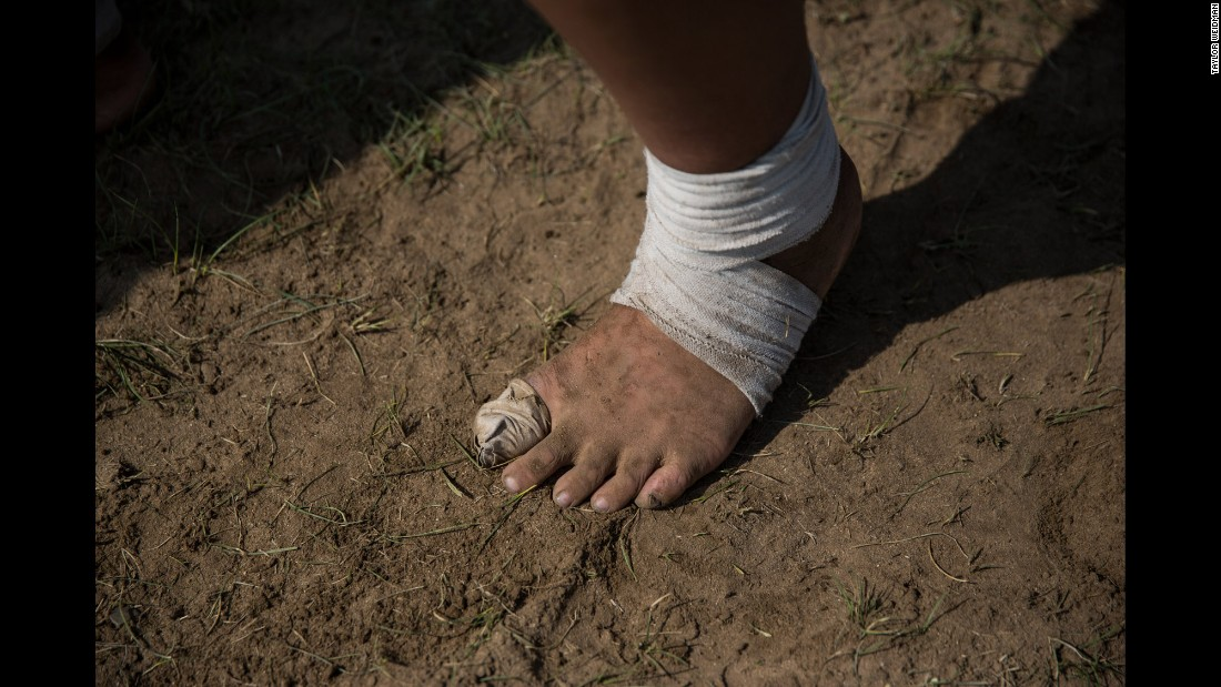 Wrestlers practice in their bare feet.