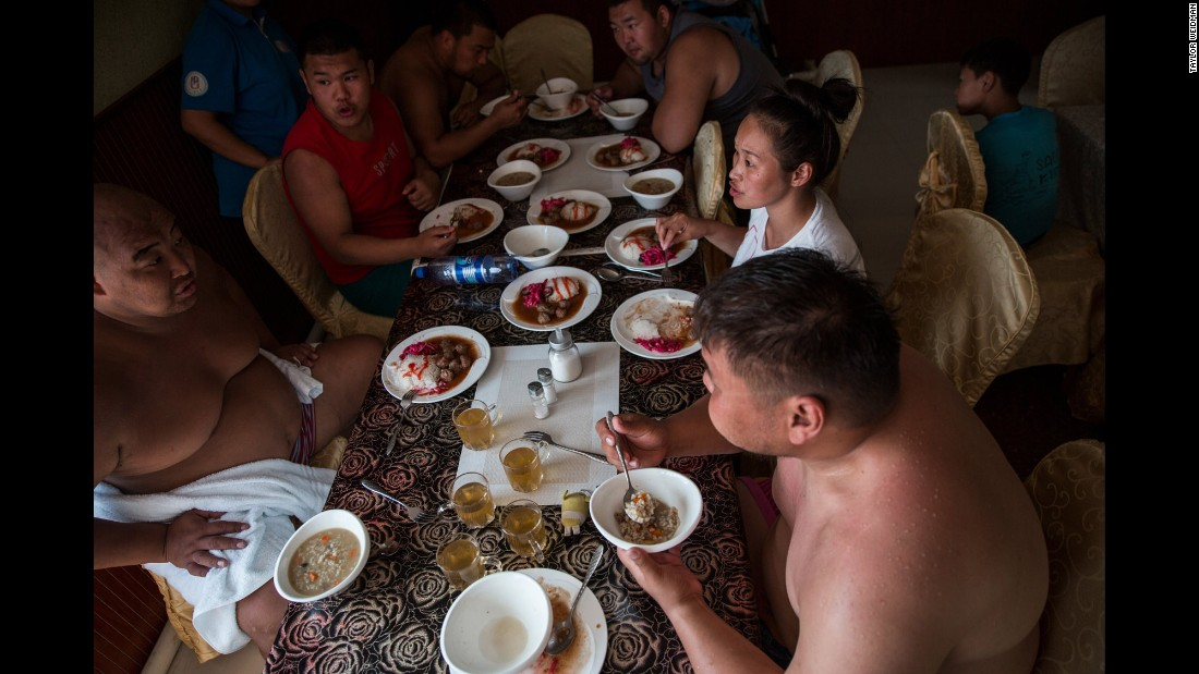 "Wrestlers eat lunch together at the training camp. ""Wrestlers would eat big meals with lots of mutton and rice,"" Weidman said. ""Traditionally, I think sumo wrestlers are supposed to have two huge meals a day, followed by naps so the calories aren't burned off right away."""