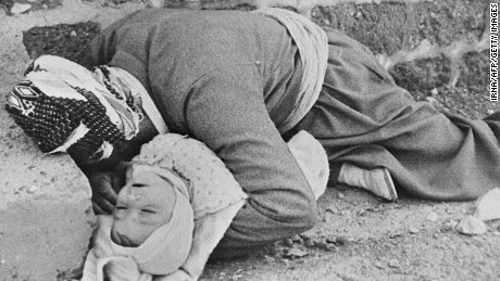 Iranian news agency IRNA released this picture in 1988 from Halabja showing a Kurd father and baby killed by an Iraqi chemical attack.