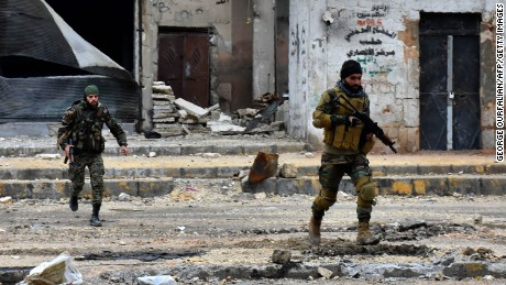 Syrian pro-government forces advance during a military operation in Aleppo on Wednesday.
