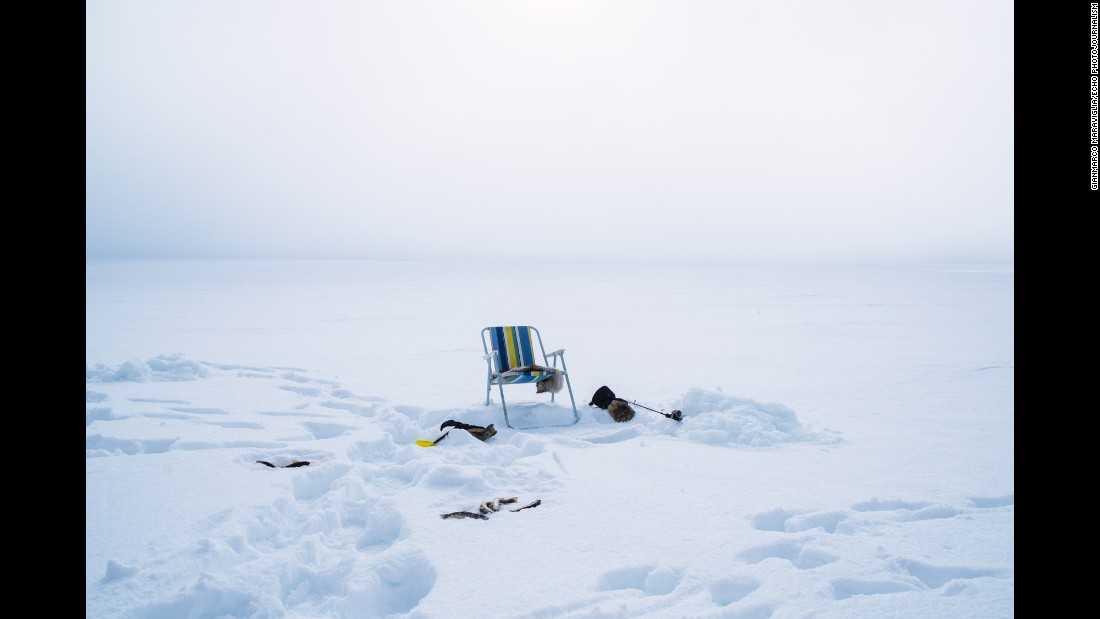 A chair in Finnmark is set up for ice fishing.