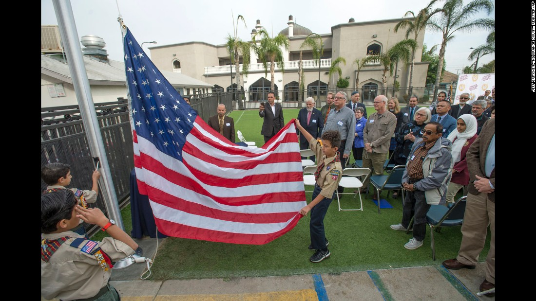 "Zakariya Baker helps raise an American flag at Orange Crescent School, an Islamic school in Garden Grove, California, before a special assembly Thursday, December 15. The school, along with many other Southern California mosques, received a threatening letter around Thanksgiving. Thursday's assembly gave the young students a chance to respond to the threats while also hearing support from community members, <a href=""http://www.ocregister.com/articles/students-738572-letter-school.html"" target=""_blank"">according to the Orange County Register.</a>"