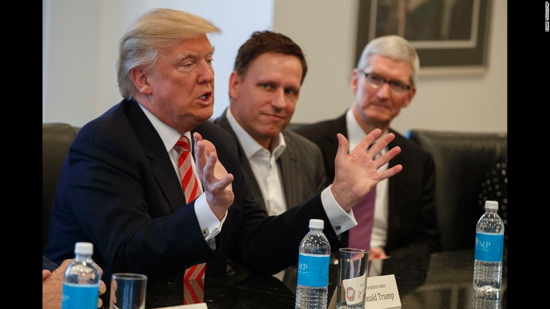 "Trump speaks during <a href=""http://money.cnn.com/2016/12/14/technology/trump-tech-summit-silicon-valley/"" target=""_blank"">a meeting with technology executives</a> in New York on Wednesday, December 14. Apple CEO Tim Cook, right, and PayPal founder Peter Thiel, center, were among those in attendance. The three main areas discussed were jobs, immigration and China, according to a source briefed on the meeting."