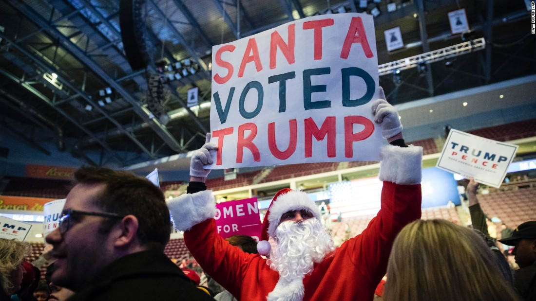 "Tyler Haines, wearing a Santa Claus outfit, shows his support for Trump ahead of a ""thank you"" rally in Hershey, Pennsylvania, on Thursday, December 15."
