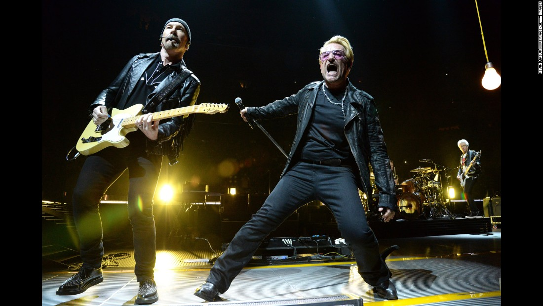 "Irish musicians The Edge, left, Bono, center, Larry Mullen on drums and bassist Adam Clayton, right, have been playing together as U2 since 1976. During those 40 years, they've regularly adapted their music to reflect their changing interests. First cracking the US Top 40 with ""Pride in the Name of Love"" in 1984, they scored their first No. 1 hit three years later with ""With or Without You."" U2 has sold 52 million units in the US, according to the Recording Industry Association of America."