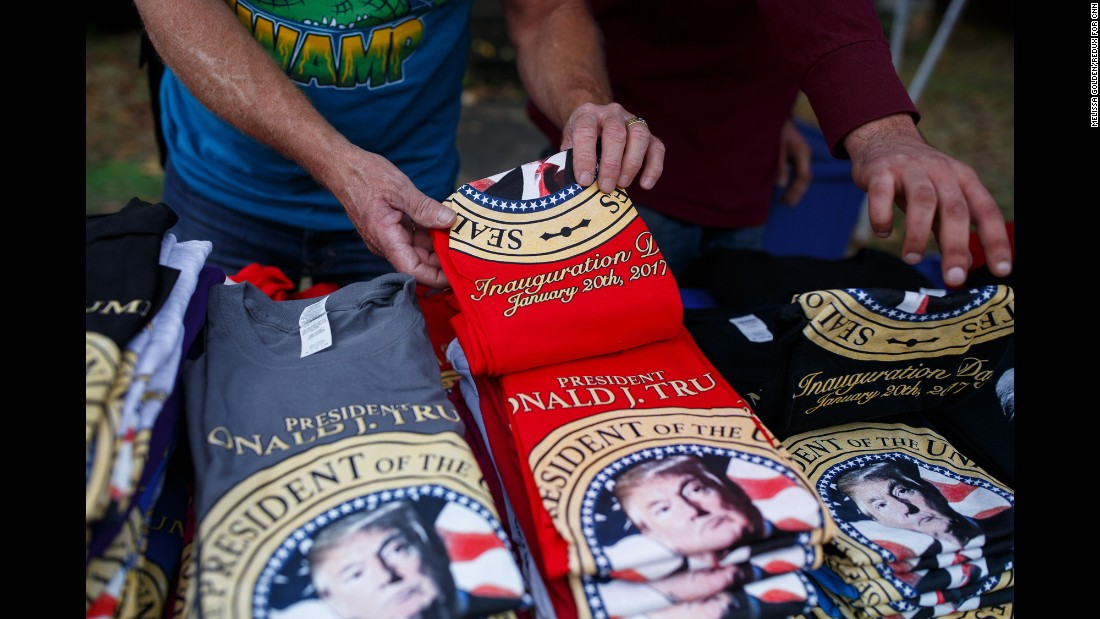 Brad White of White Hot Tees sets out inauguration-themed shirts at his stand outside the stadium. Trump will be sworn in as the 45th President of the United States on January 20.