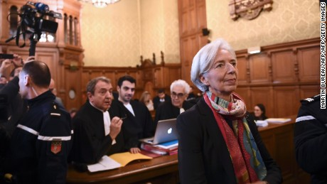IMF chief Christine Lagarde (R) and her lawyer Patrick Maisonneuve (Rear L) look on in a courtroom of the Paris courthouse on December 12, 2016 prior to the start of Lagarde's trial before the Court of Justice of the Republic, a special tribunal used to try ministers. IMF chief Christine Lagarde goes on trial in France on December 12 over a massive state payout to a flamboyant tycoon when she was finance minister in a case that risks tarnishing her stellar career. / AFP / Martin BUREAU        (Photo credit should read MARTIN BUREAU/AFP/Getty Images)